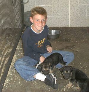 Eric_and_two_pups_6_11_2005.jpg